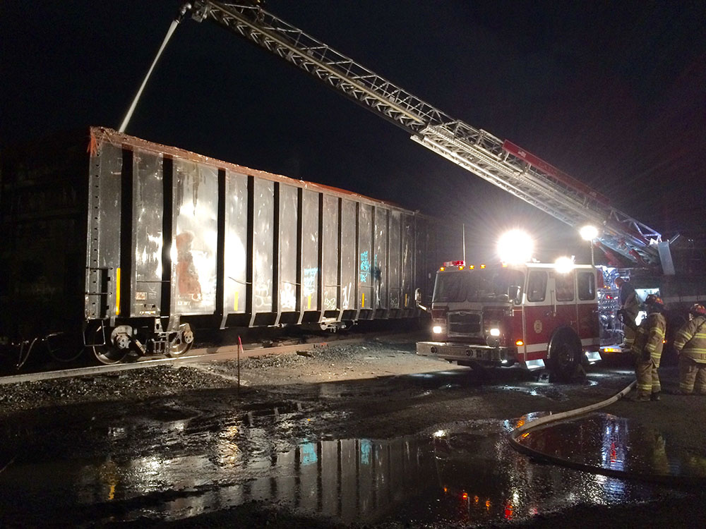 Open top box car on fire